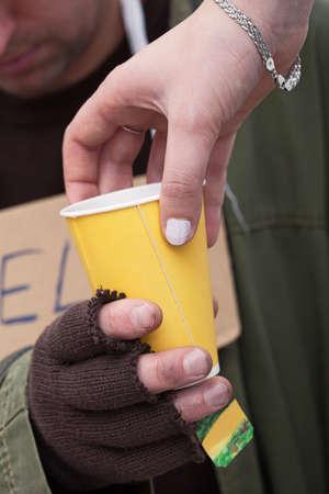 Hot drink for a homeless beggar, closeup Stock Photo - 24368934