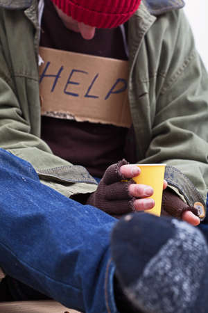 Poor man begging for a help with tea cup Stock Photo - 24368936