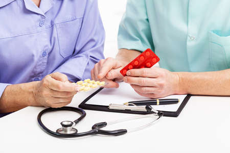 doctor giving pills: Doctor giving pills for a patient, isolated background