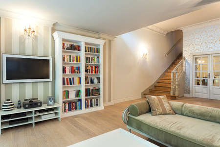Vintage mansion - a striped wall with a tv set and a white bookshelf Stock Photo - 24368954