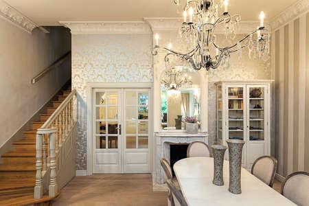 Vintage mansion - a luxurious interior with stairs and a dining area photo