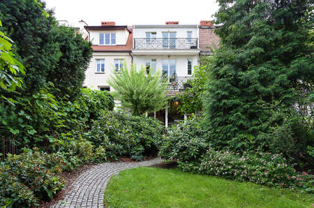 Vintage mansion - a garden with a path surrounded by plants photo