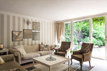 Vintage mansion - a corner with a striped wall in a luxurious apartment