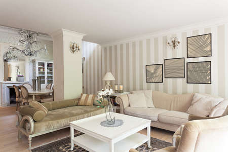 interior design living room: Vintage mansion - a stylish retro drawing room in beige