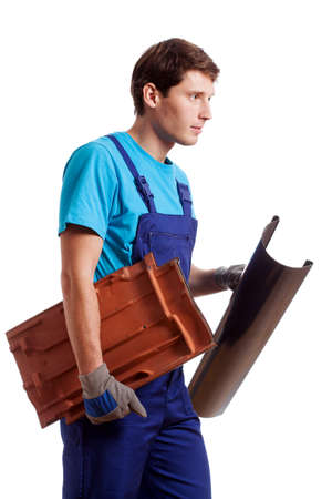 Handyman on isolated background holding a gutter Stock Photo