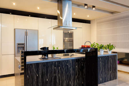 kitchen counter top: Urban apartment - Black counter top in modern kitchen