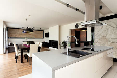 kitchen counter top: Urban apartment - bright house interior with black additions Stock Photo