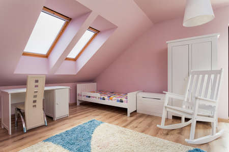 Urban apartment - pink room on the attic photo