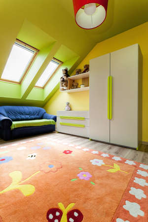 play room: Urban apartment - colorful room on the attic