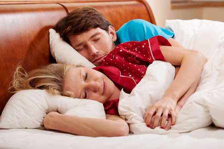 nightclothes: Couple hugging during sleeping in the nightclothes  Stock Photo