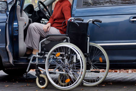 disabled seniors: Elder disabled person driving a car Stock Photo