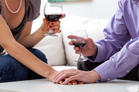 abusing: A closeup of lovers drinking a glass of red wine Stock Photo