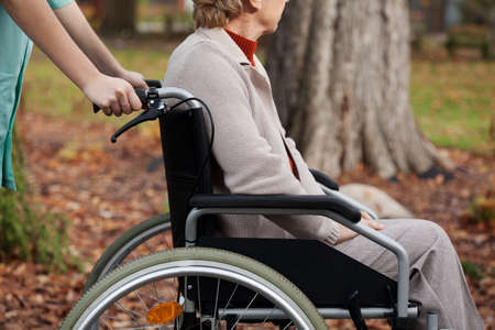 home nursing: Disabled elder woman on wheelchair with nurse