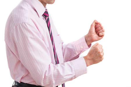 clenching fists: A businessman clenching his fists with irritation