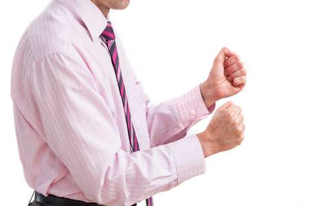 comunicacion no verbal: Un hombre de negocios apretando los puños con la irritación