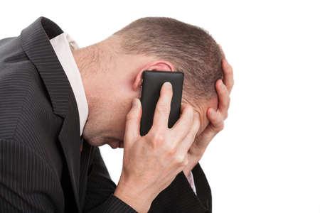 comunicacion no verbal: Un hombre de negocios joven que tiene una conversación muy estresante Foto de archivo