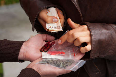 illegal substance: Young woman buying drugs and checking  order