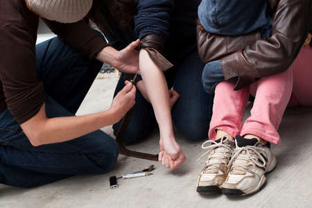 illegal drug: Adult man injecting drugs to other person Stock Photo