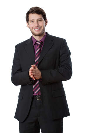 Businessman wearing suit and tie clapping in his hands photo