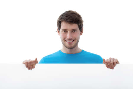 Young smiled man holding a white board photo
