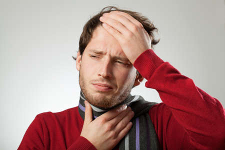 Man with headache and strong sore throat probably has cold Stock Photo