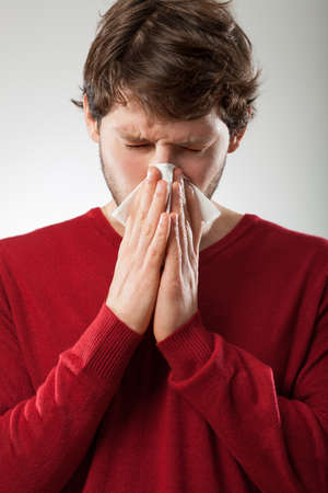 Sick man isolated has runny nose Stock Photo