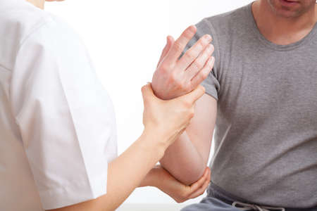 Patient with elbow ache has rehabilitation in physiotherapy clinic