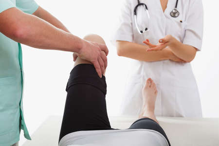broken knee: Young girl with knee disease on physiotherapy visit Stock Photo