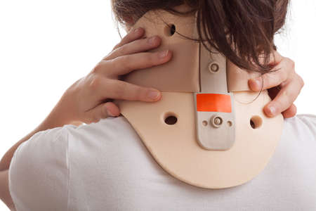 Girl with neck ache has a cervical collar Imagens