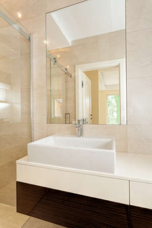 vessel sink: White rectangular vessel sink in modern bathroom, vertical