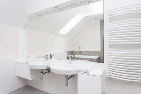 double sink: White modern bathroom interior with double sink