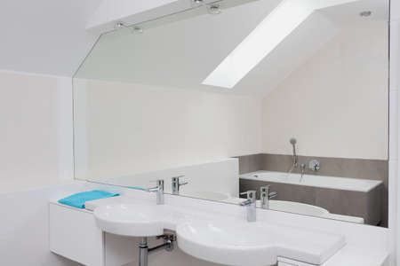 Luxury bathroom with huge mirror and two sinks photo