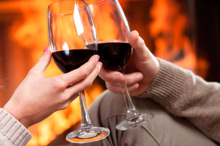 proposing a toast: A closeup of cheering with glasses of red wine Stock Photo