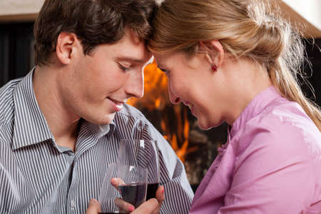 A closeup of people in love drinking red wine Stock Photo - 24568513