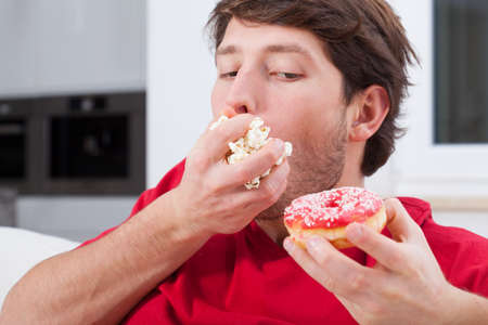 couches: Man cant help eating sweet and junk food