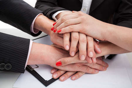 Hands of team members expressing unity photo