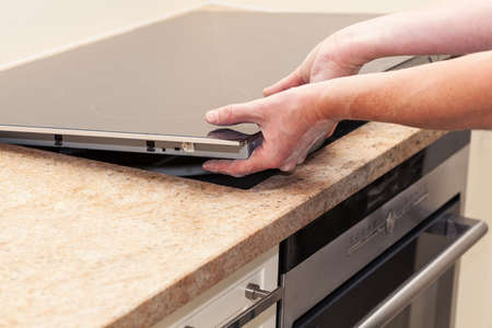 induction: Installing new induction hob in modern kitchen