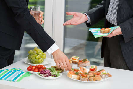 lunch meeting: Business people having colorful appetizing meal together at the meeting Stock Photo