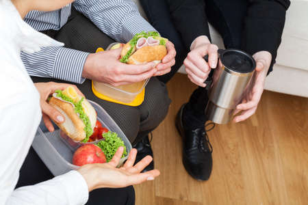 second meal: Office workers have a break from work to eat second breakfast Stock Photo