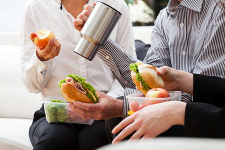 second breakfast: Fast break to eat second breakfast meal during work on project Stock Photo