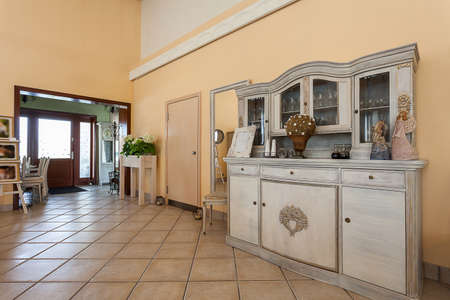 Mediterranean interior - a pastel hall with antique wardrobe photo