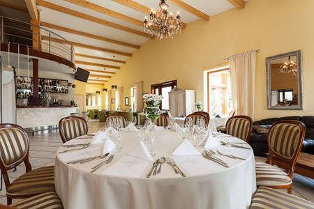 Mediterranean interior - an elegant set table in a restaurant photo