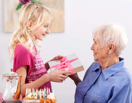 grannies: A granddaughter with a birthday present for her granny