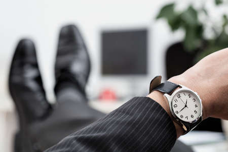 disrespectful: A close up of a businessmans elegant watch Stock Photo