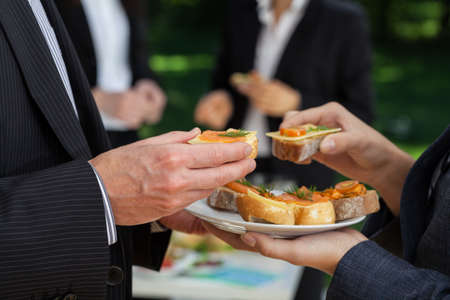 outdoor event: Manegers conversations at the office buffet during lunch Stock Photo