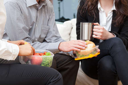 Business people are eating breakfast on break in the office Stock Photo - 24824503