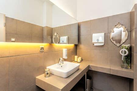 Mediterranean interior - a modern restroom with a big mirror Stock Photo - 24824475