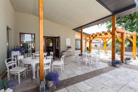mediterranean interior: Mediterranean interior - a spacious veranda with white furniture