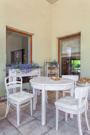 mediterranean interior: Mediterranean interior - an outdoors dining room with white furniture Stock Photo