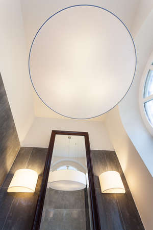 Long tall mirror and round white lamp Stock Photo - 24824494